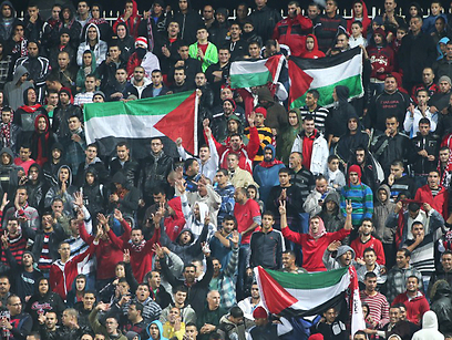 Arab fans of Benei Sakhnin waved Palestinian flags during the match against Beitar