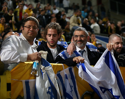 MK Michael Ben-Ari and Followers are seen at the Benei Sakhnin vs. Beitar Jerusalem waving Israeli Flags
